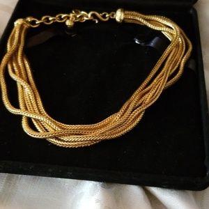 Toursaude gold tone necklace.